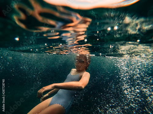 Girl swimming in the sea water Canvas Print