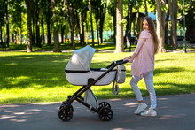 Young Mom Walks With Stroller ...