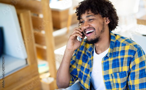 Happy afro man talking on the phone Canvas Print