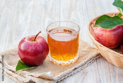 Fotografie, Tablou  Apple juice in a glass. Selective focus.
