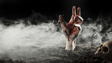 Blood Hand Sticking Out Of Ground In Fog