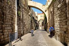 Kids Go To School Along Narrow Stone Street In Old City Of Jerusalem, Israel. May 2017