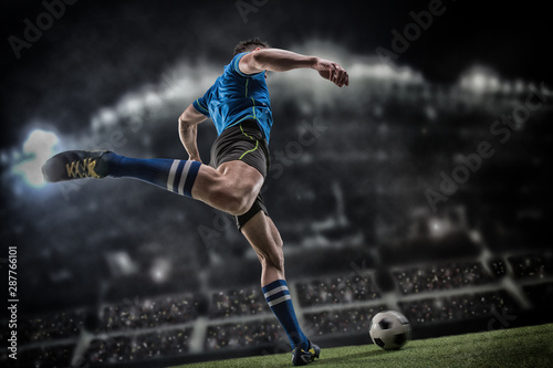 Fotografie, Obraz  Football player with ball on field of stadium