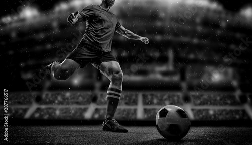 Football player with ball on field of stadium Tablou Canvas