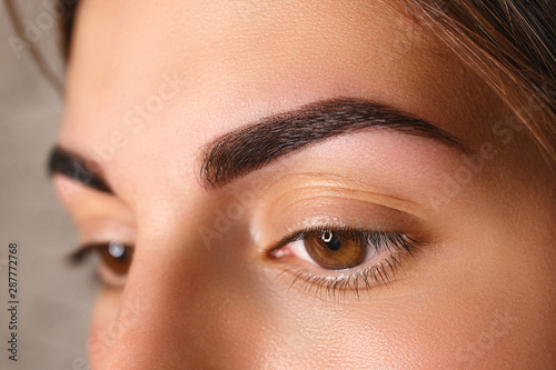 Fotografering  Young woman with beautiful eyebrows after correction, closeup