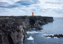 Lighthouse On The Rocks In The Iceland. High Rocks And Lighthouse At The Day Time. Natural Landscape At The Summer. Iceland - Image