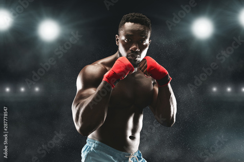 Photographie Confident black fighter standing in pose and ready to fight