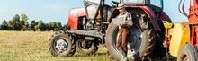 Panoramic Shot Of Farmer In Straw Hat Using Laptop Near Tractor
