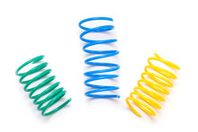 Yellow, Green And Blue Plastic Spring Toy Or Spirals Isolated On White Background