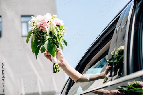 Fototapety, obrazy: cropped view of young adult bride holding holding bouquet