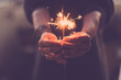 canvas print picture - Concept of party nightlife and new year eve 2020 - close up of people hands with red fire sparklers to celebrate the night and the new start - warm colors filter