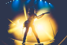 Silhouette Of An Unrecognizable Woman Playing The Electric Guitar