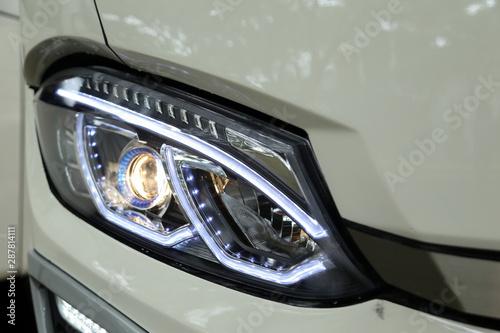 Fototapeta Modern & luxury front bus headlight or headlamp led close up obraz na płótnie