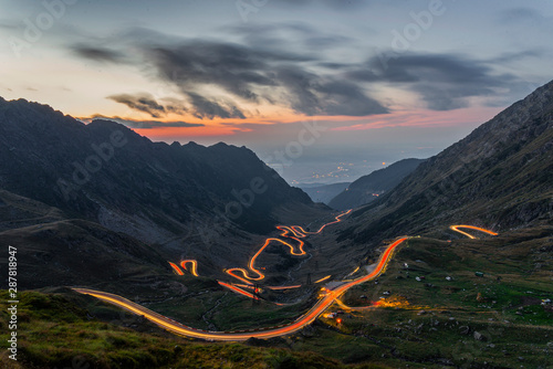 Obraz Traffic trails on Transfagarasan pass,crossing Carpathian mountains in Romania, Transfagarasan is one of the most spectacular mountain roads in the world - fototapety do salonu