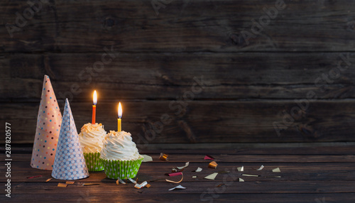 Fotomural birthday cupcakes with candles on old dark  wooden background