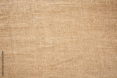 Fotografiet  Woven brown horizontal fabric background flat lay from above