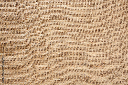 Canvastavla  Woven brown horizontal fabric background flat lay from above