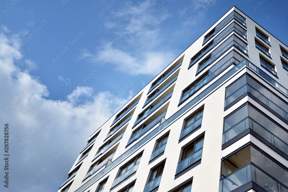 Fototapeta Modern and new apartment building. Multistoried modern, new and stylish living block of flats.