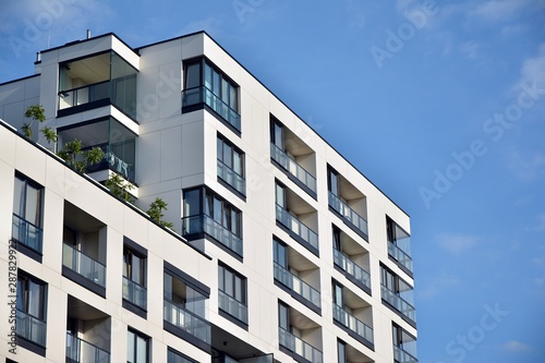 Fototapety, obrazy: Modern and new apartment building. Multistoried modern, new and stylish living block of flats.