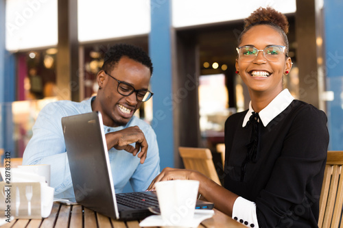 Fototapety, obrazy: Black  African American coworkers doing digital teamwork arround a coffee cup