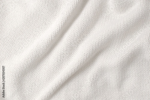 Fotomural  White, thick woollen sweater. Texture detail.
