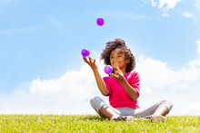Positive Happy Girl Juggle Balls On The Grass