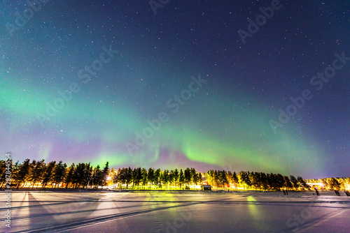 Northern lights over Jokkmokk and the Lake Talvatis, in the heart of Swedish Lapland within the Arctic Circle