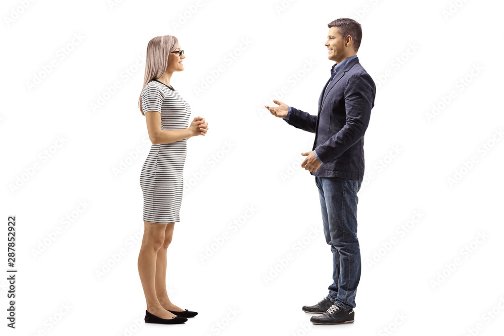 Fototapeta Yung man and woman standing and talking