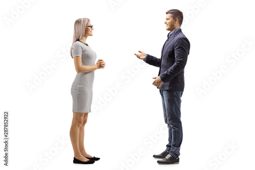 Fototapeta Yung man and woman standing and talking obraz