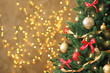canvas print picture Beautiful Christmas tree with decor against blurred lights on background