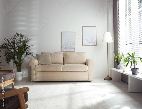 Vászonkép  Living room interior with comfortable sofa near window