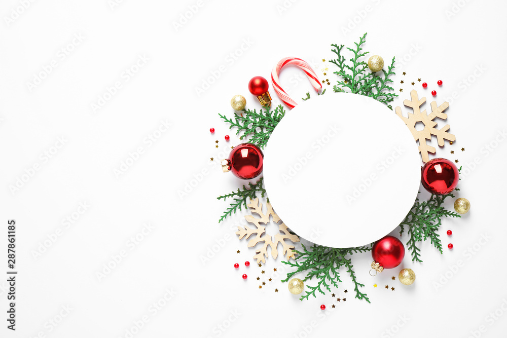 Fototapeta Flat lay composition with Christmas decor and blank card on white background. Space for text