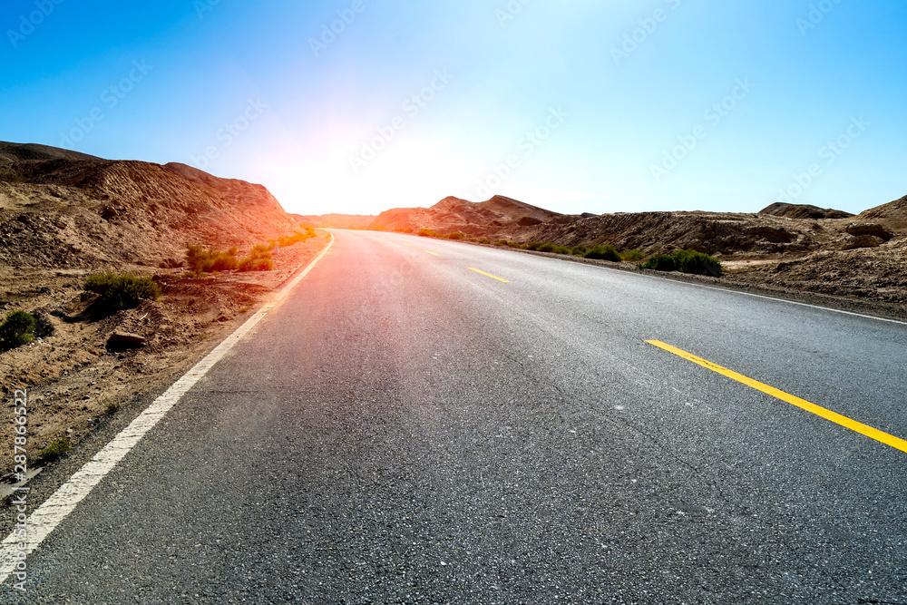 Fototapeta Road straight ahead to desert