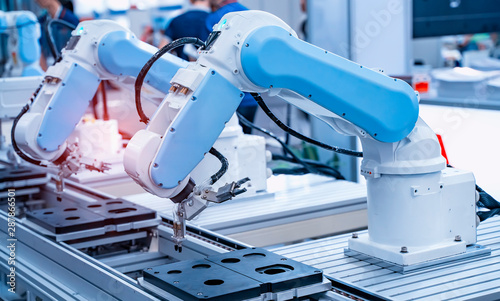 Obraz robotic arm catch for electronic assembly line. The robot for smart technology manufacturing process. - fototapety do salonu