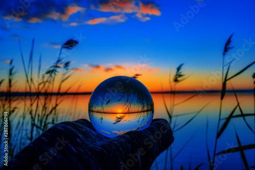 Foto auf Leinwand Dunkelblau Sunset with lensball