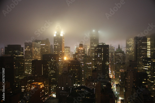 New York City landscape at night with lights building translucid by the fog