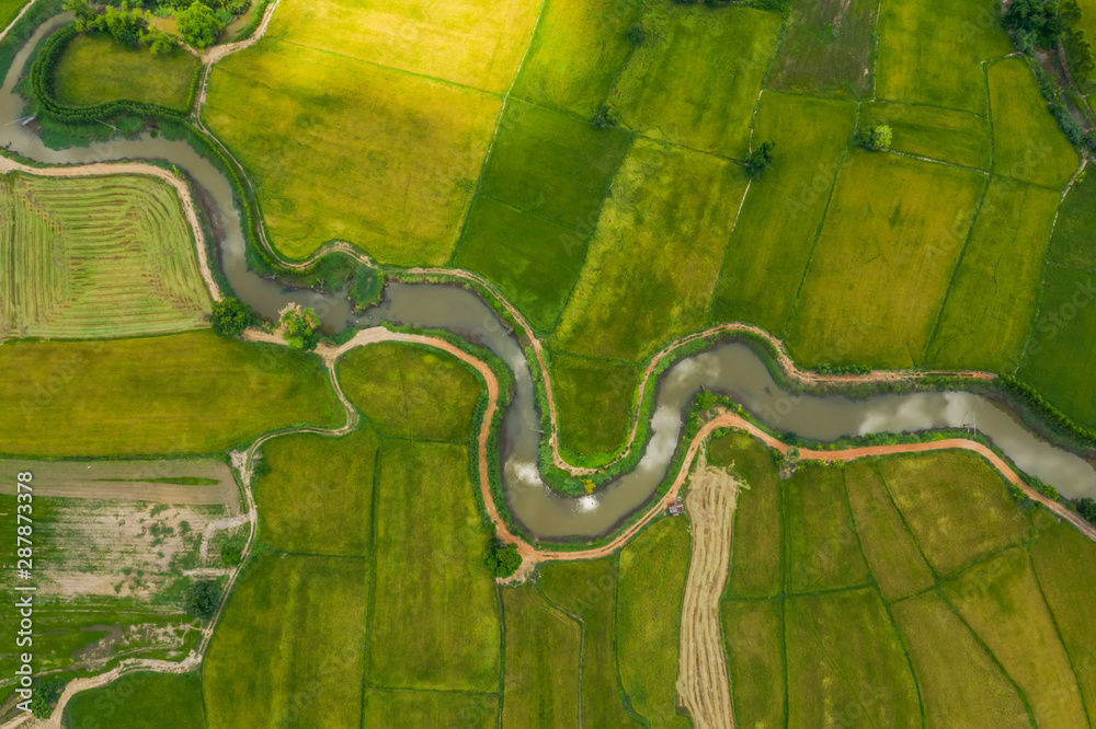 Fototapeta aerial view of devious river in a fields