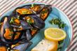 Leinwanddruck Bild Mussels with lemon sauce is tasty dish