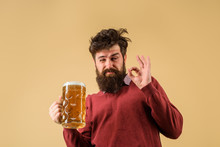 Bearded Drunk Hipster Male Holds Craft Beer. Bad Habits. Bearded Man Drinking Beer From Glass At Bar Or Pub. Drinks, Alcohol, Leisure And People Concept. Stylish Man With Beard Holds Mug Of Beer.