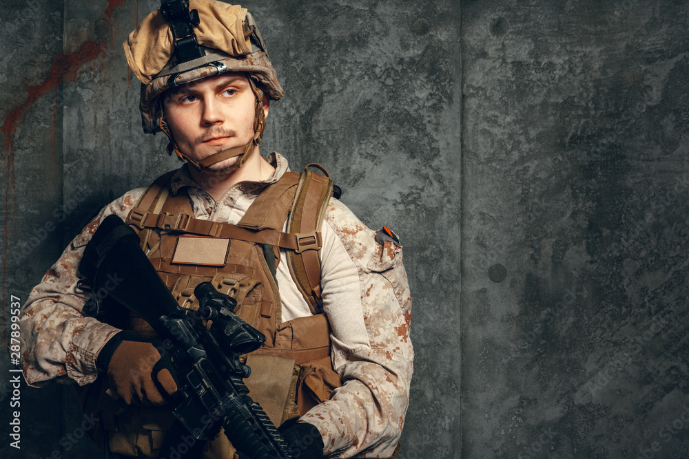 Fototapety, obrazy: fully equipped army soldier in camo uniform and helmet, armed with pistol and assault service rifle