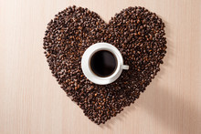 Coffee Cup In The Middle Of Shape Love Coffee Beans On The Wooden Background