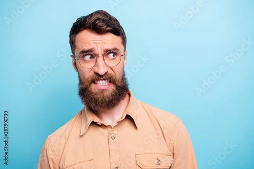 Fotografija  Close up photo of frustrated guy looking wearing brown shirt eyewear eyeglasses