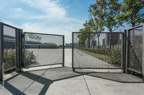 Obraz Wrought iron gate and stone pillar isolated on white background. - fototapety do salonu