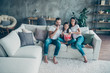 canvas print picture Portrait of nice attractive lovely cheerful friendly idyllic family wearing casual white t-shirts jeans denim sitting on sofa enjoying video holiday at industrial style interior living-room