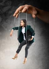 Hand Of Puppeteer Manipulating...