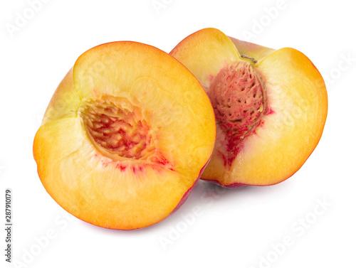 Photo  Ripe cut peach on white background