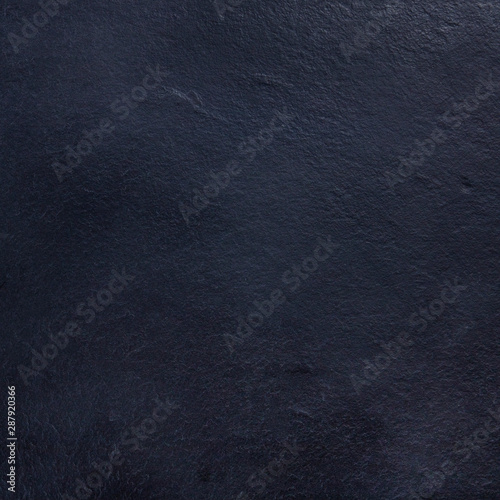 An abstract black slate background, a dark texture with a place for text