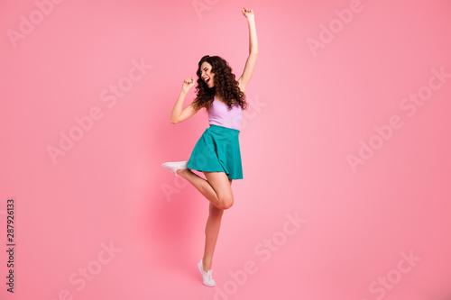 Full length body size photo of nice cute fascinating cheerful girl wearing singlet dancing while singing isolated with pink background - 287926133