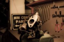 Old Carburetor On A Workbench