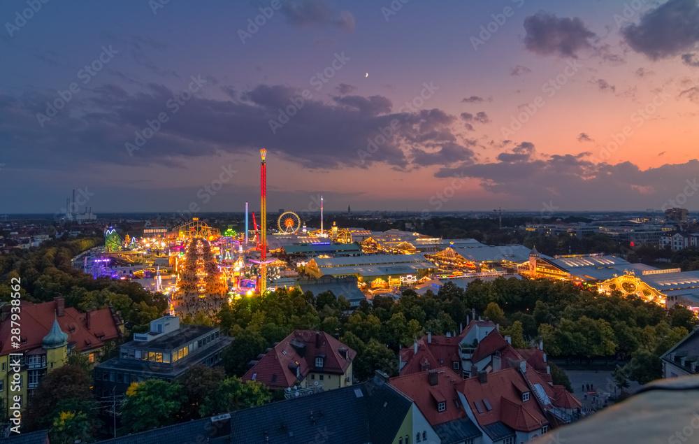 Fototapeta Oktoberfest in Munich from a high view at sunset.